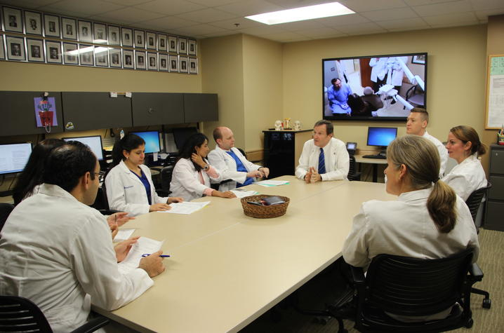 residents meeting with clinic faculty in the current clinic location to discuss patient cases