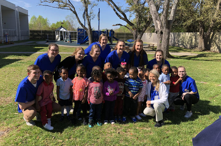 Photo of HHS 357 students with children