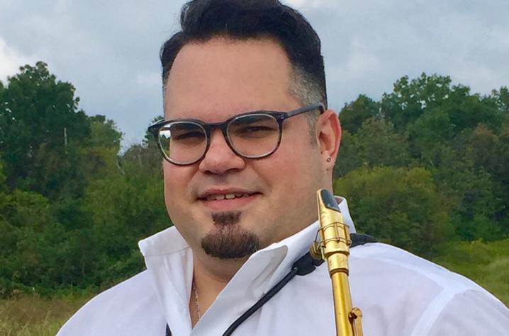photo of Ian Cruz with saxophone