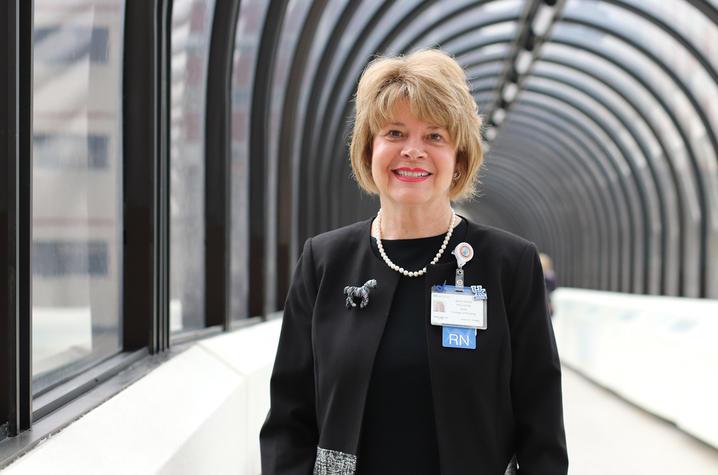 Image of Janie Heath in exterior cooridor.