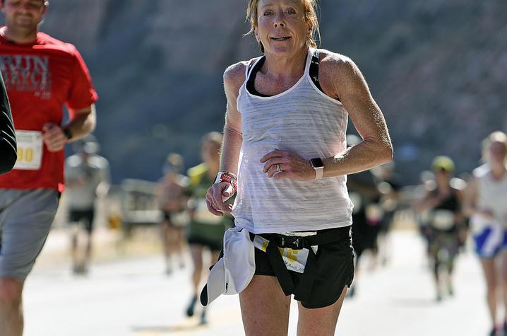 Lisa running the Moab half marathon