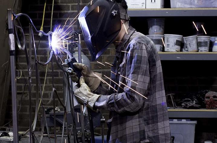 photo of student in Fine Arts Institute metalworking class