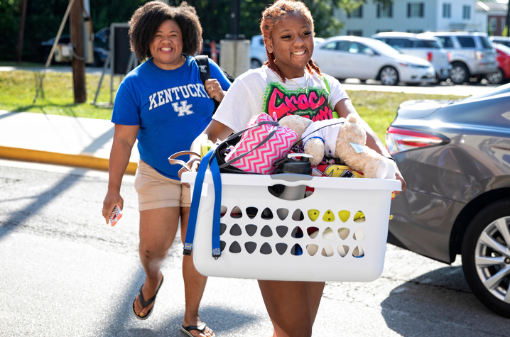 Mother helping daughter move-in.