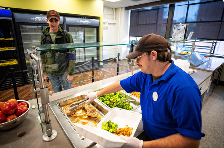 photo of student getting a meal at ONE Community Cafe