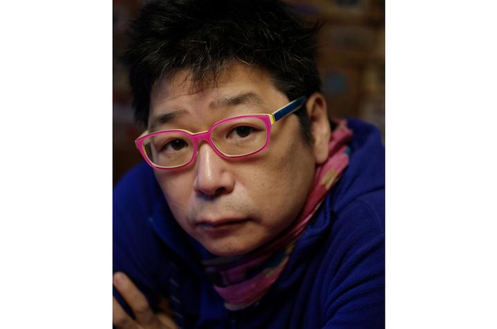 headshot photo of Osamu James Nakagawa