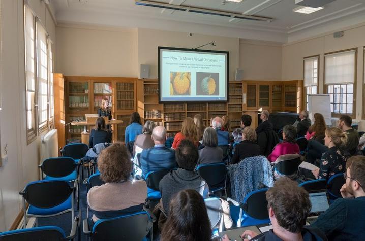 photo of Kyra Seevers explaining photogrammetry