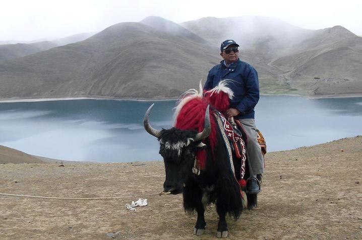 photo of P.P. Karan riding animal