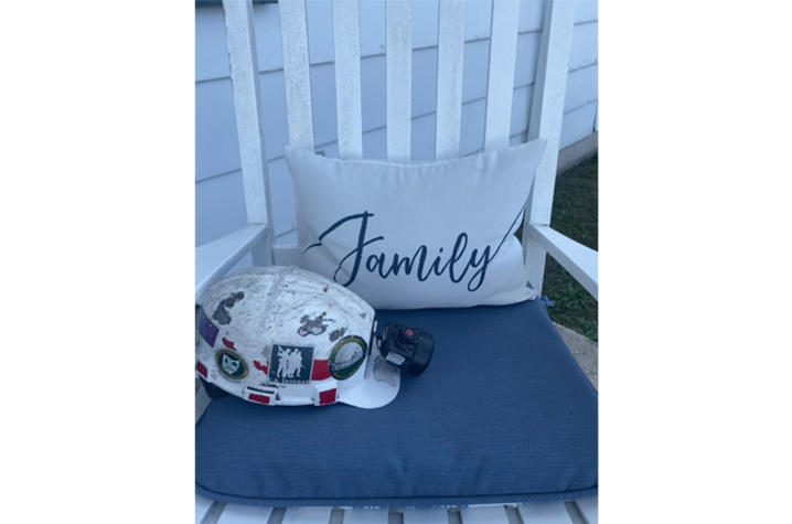 Image of hard hat in rocking chair