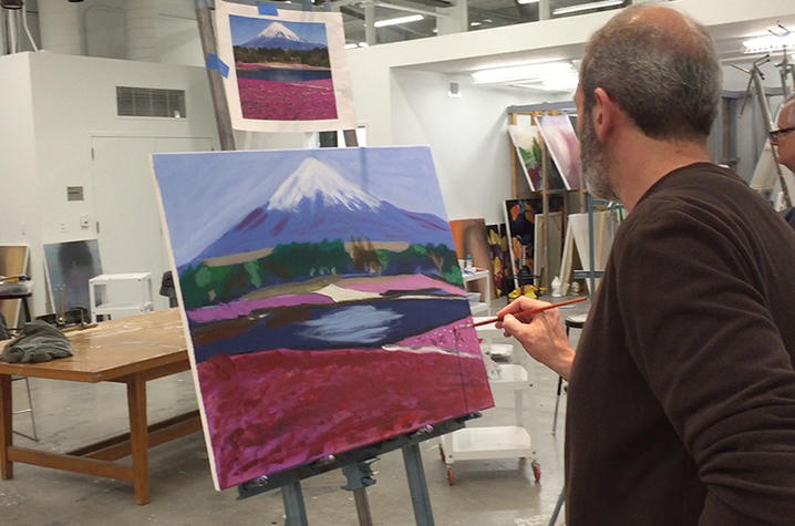photo of student in painting class at Fine Arts Institute