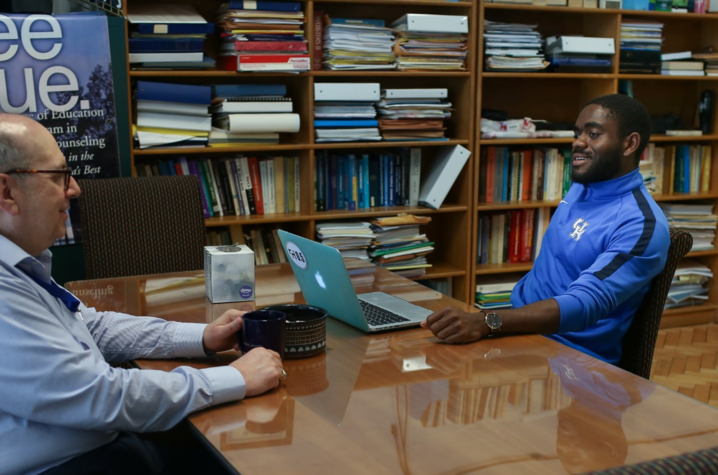 Ralph Crystal with student with laptop at desk