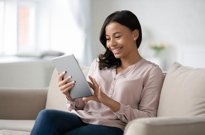 Woman working on her iPad.