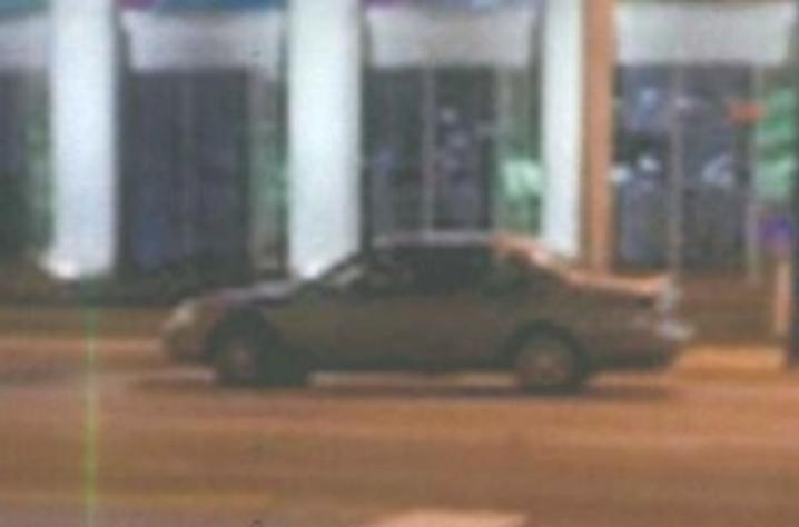 Suspect left the scene in an early 2000s gold Toyota Camry. Photo from a safety camera on campus.