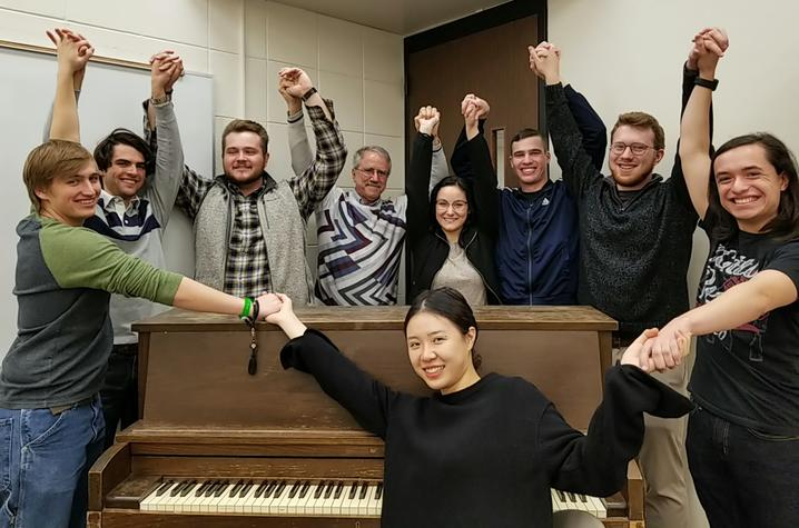 photo of students in UK's 2019 Russian singing class with pianist