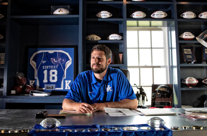 This is a photo of Jacob Tamme in his office.
