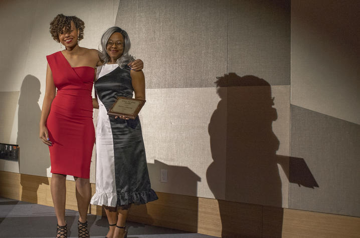 Kennedy Guess presents Brianna Armstrong with the Still We Rise award