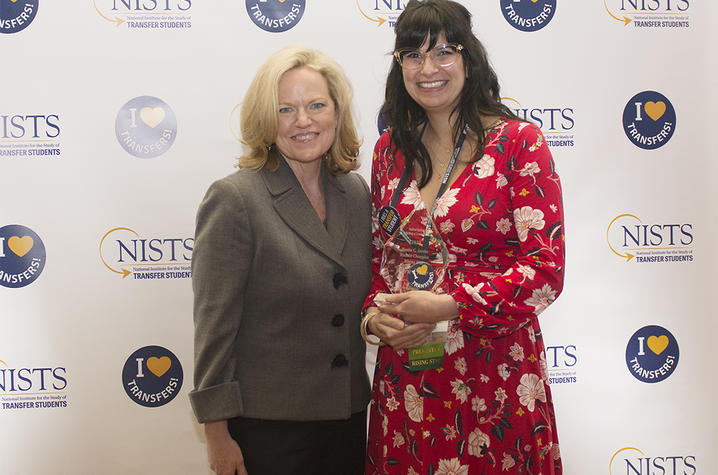 Dr. Janet Marling on left and Sara Price on right holding award
