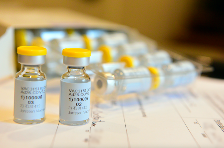 Vials of the Janssen/Johnson & Johnson COVID-19 vaccine candidate sit on a table.