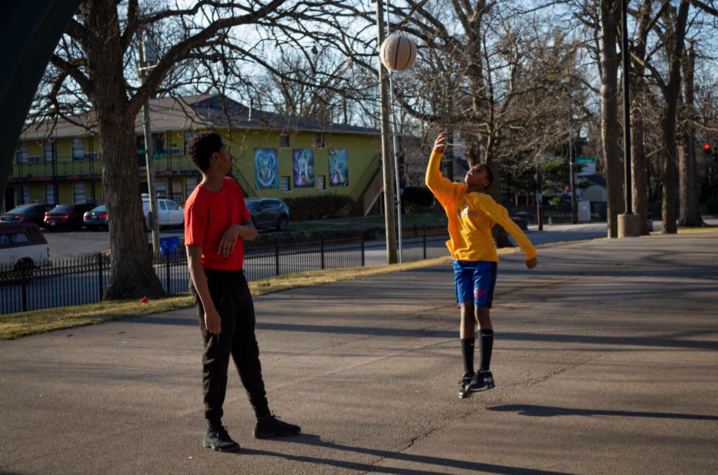 Bryan Greene, 25, and Lakell Gates, 11, play basketball on the court in Duncan Park in Lexington, Kentucky, on Sunday, Feb. 2, 2020.