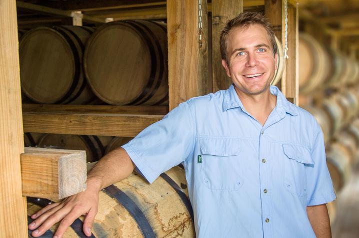 photo of Seth Debolt among bourbon barrels