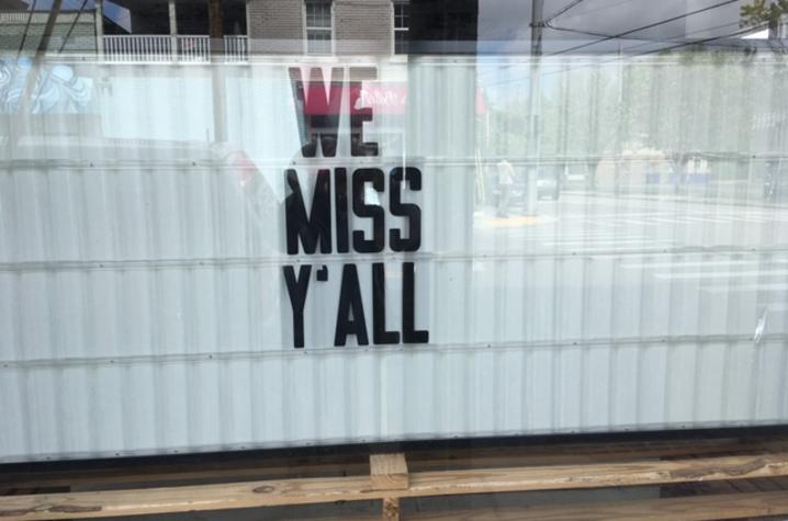 """photo of signage in shop window on May 2, 2020 - """"In This Together"""""""