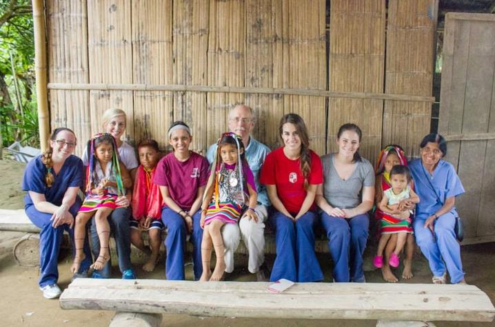 Dr. Thomas Young and Dr. Nirmala S. Desai with students and patients