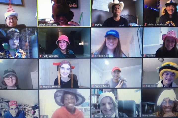 photo of 16 screens of GSA students in hats as part of an RA group meeting