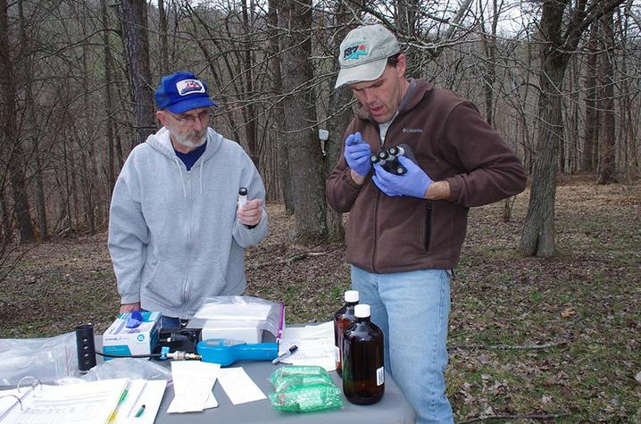Richard Smath and Steve Webb of KGS collect and label groundwater samples for the northeastern Kentucky well-sampling project.