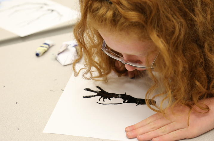 photo of student working on art at  2 kids eating at UK Confucius Institute Spring Break Camp