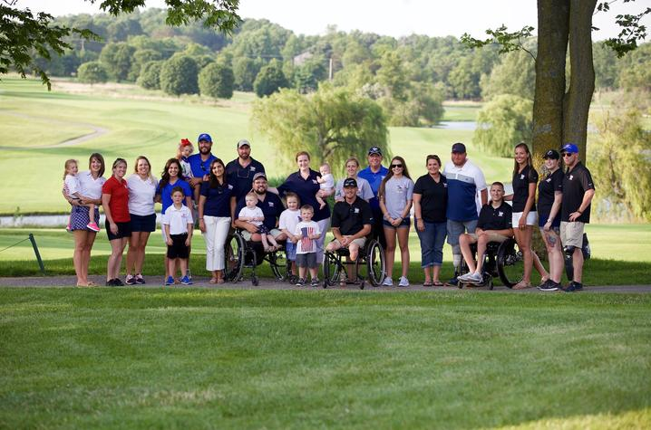 "This is a photo of the ""Swings for Soldiers"" family."
