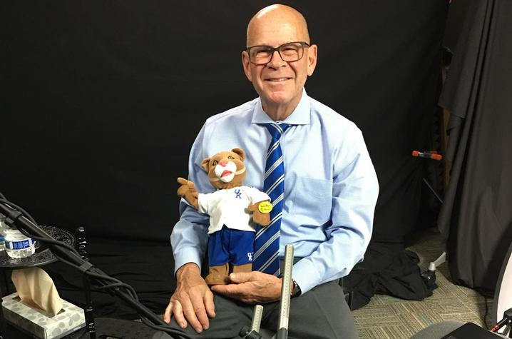 photo of T. Lynn Williamson with Wildcat doll after oral history interview