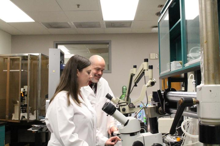 Photo of Jenna Gollihue and Chris Norris at the Sanders-Brown Center on Aging