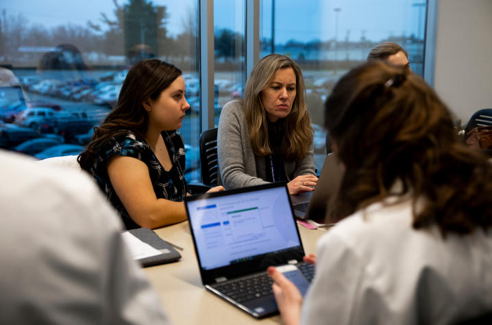 Students participate in a 'lunch and learn' activity as part of their TEAM Clinic experience