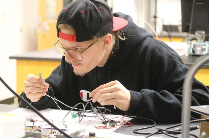 photo of Travis (TJ) Schuyler in lab