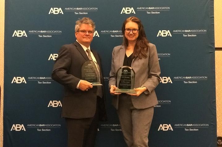 Law students Amanda Krugler and Scott Sullivan pose with awards