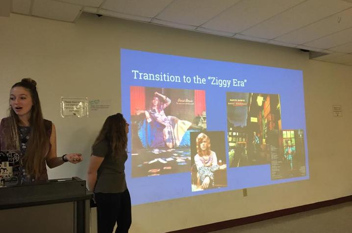 photo of students presenting on David Bowie