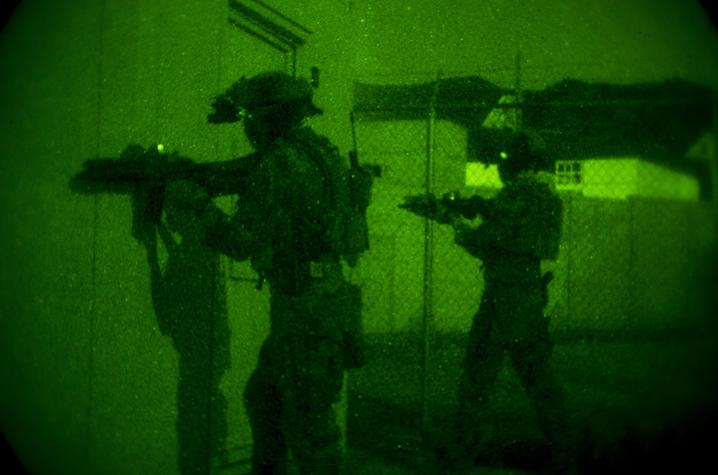 U.S. Marine Corps Forces, Special Operations Command provide security during a night raid. Photo By Cpl. Steven Fox