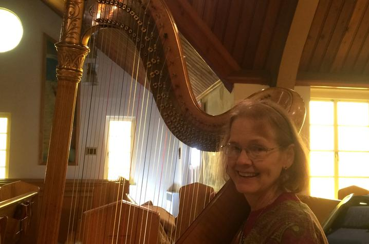 photo of Elaine Cook with Thomas Harlan's Lyon & Healy harp