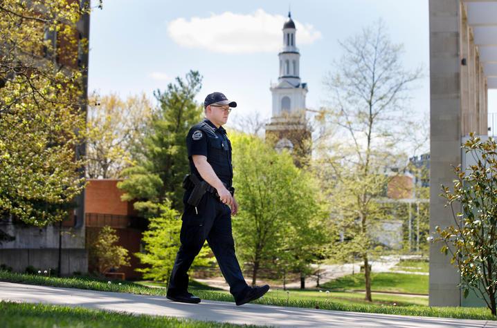 UK Police officer walking across campus