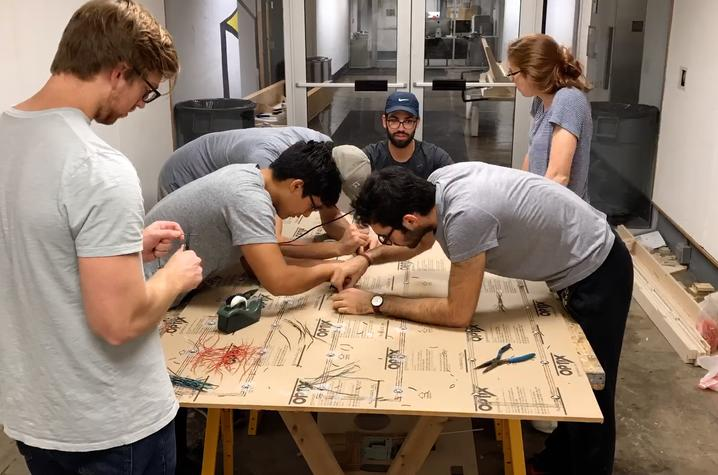 photo of UK College of Design students working on LED installation