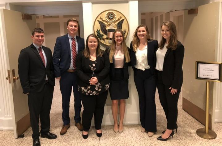 Six UK Law Moot Court Team Students dressed in professional attire