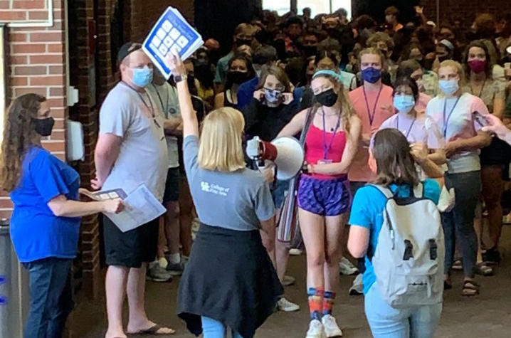 photo of Emma Lucas directing masked GSA 2021 students out of Singletary Center