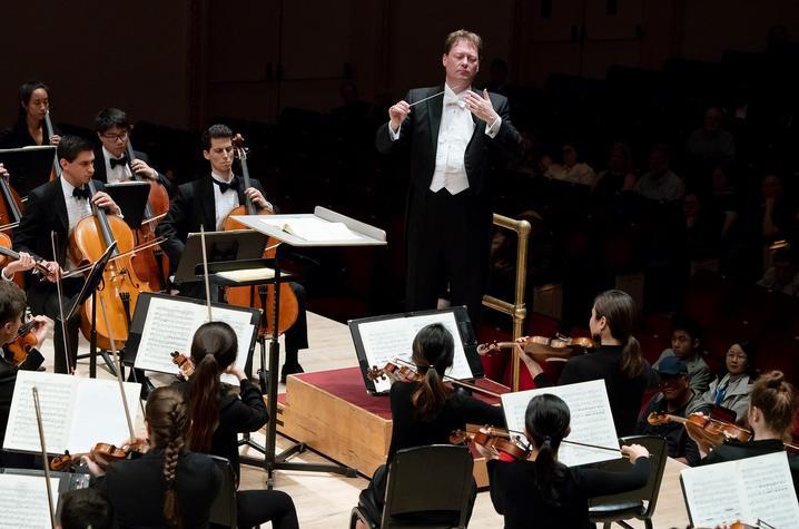 photo of John Nardolillo conducting members of UK Symphony Orchestra at Carnegie Hall