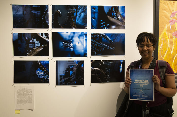 """photo of Vanessa Cordero Liberato with 2nd place award and """"Obscure Tales"""""""