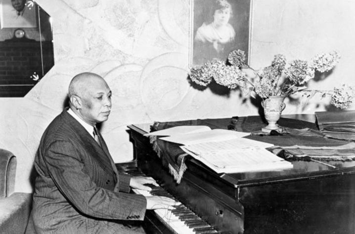 black and white photo of WC Handy playing piano in Henderson