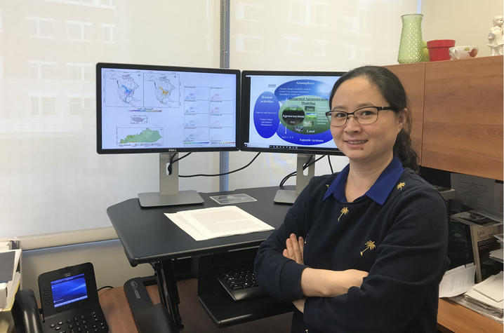 Wei Ren pictured with monitors in office