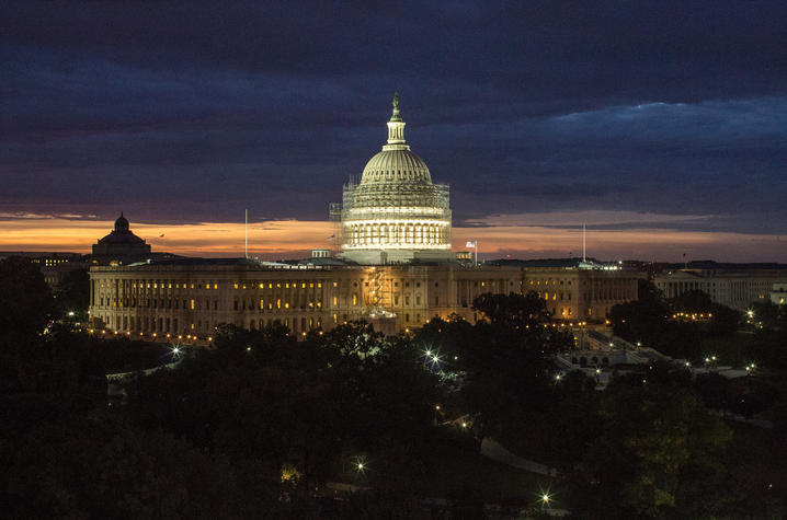 photo of restoration on U.S. Capitol dome at night