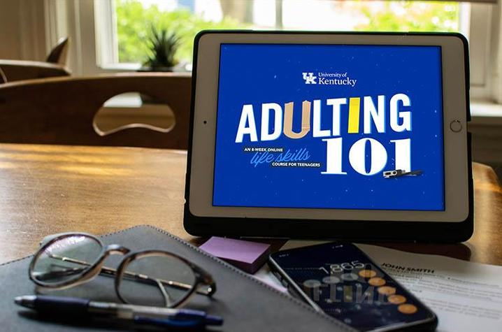 Tablet with Adulting 101 logo on screen