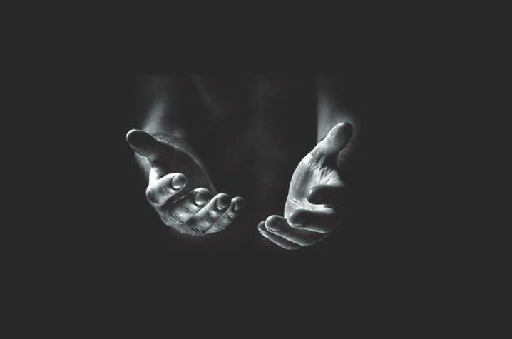 black and white photo of hands reached out