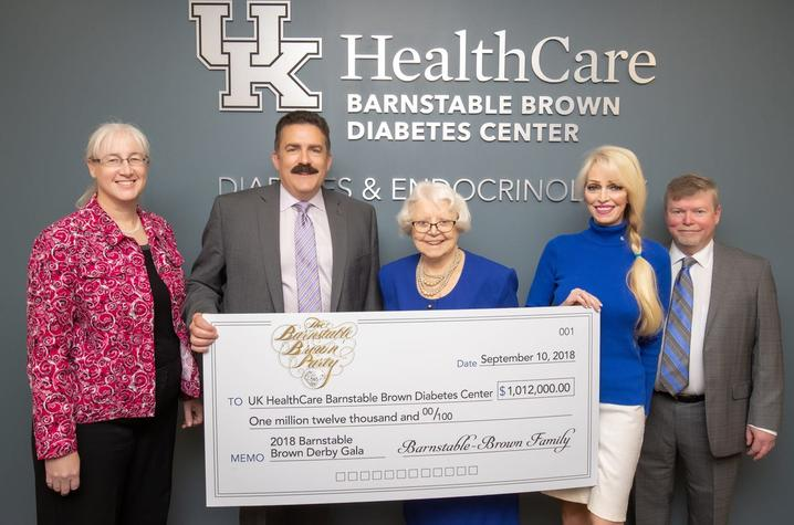 2018 check presentation to UK HealthCare's Barnstable Brown Diabetes Center. Left to Right – Dr. Lisa Tannock, Dr. Mark F. Newman, Willie Barnstable, Tricia Barnstable-Brown, Dr. John Fowlkes