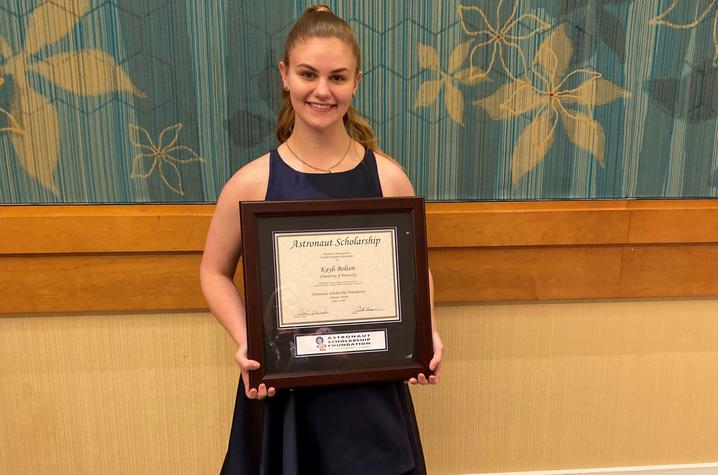 photo of Kayli Bolton holding ASF plaque